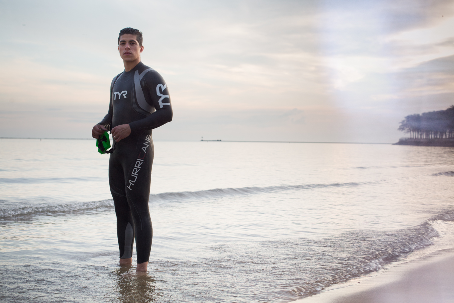 man-in-a-wetsuit-on-the-beach