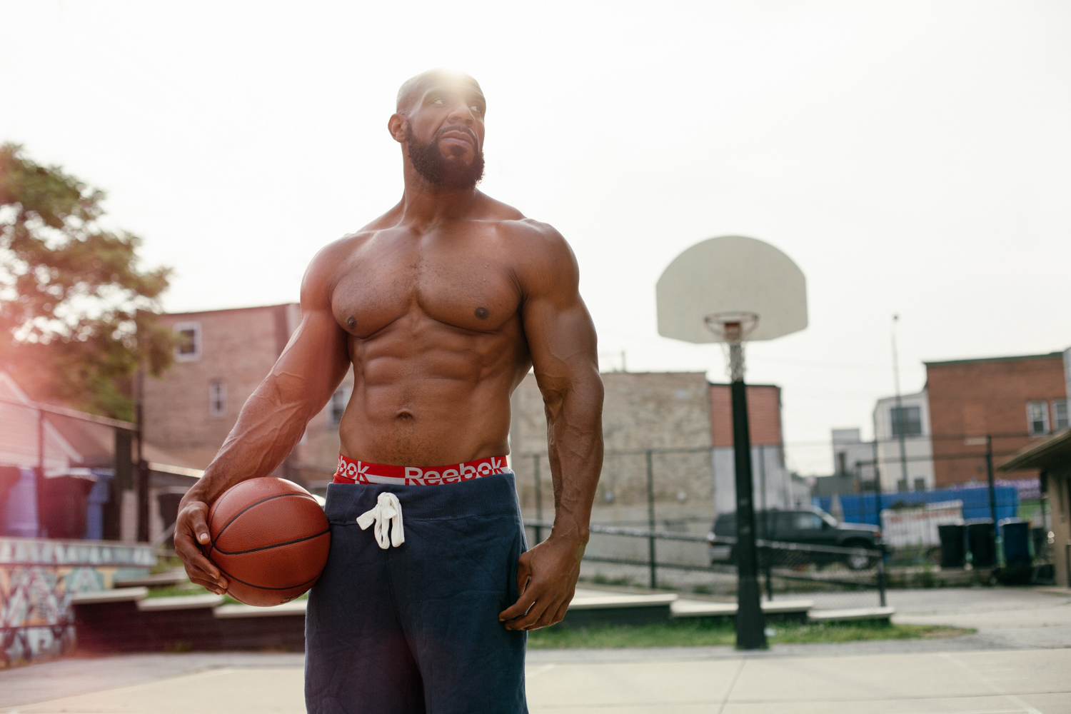 man-poses-for-basketball-photo