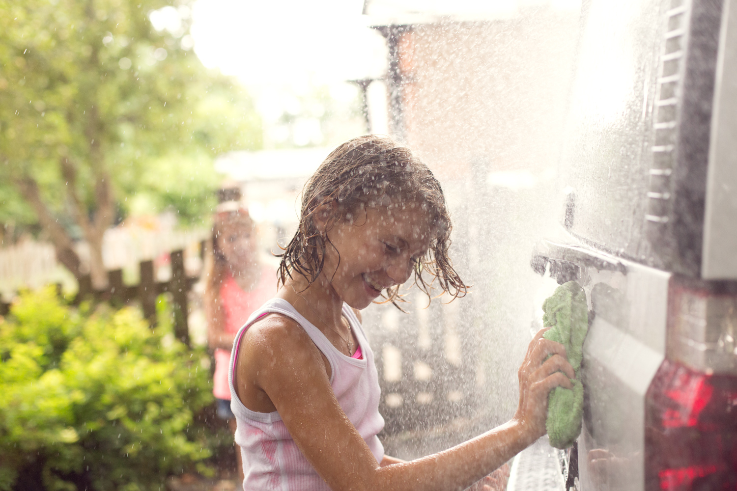 girl-washing-the-family-car